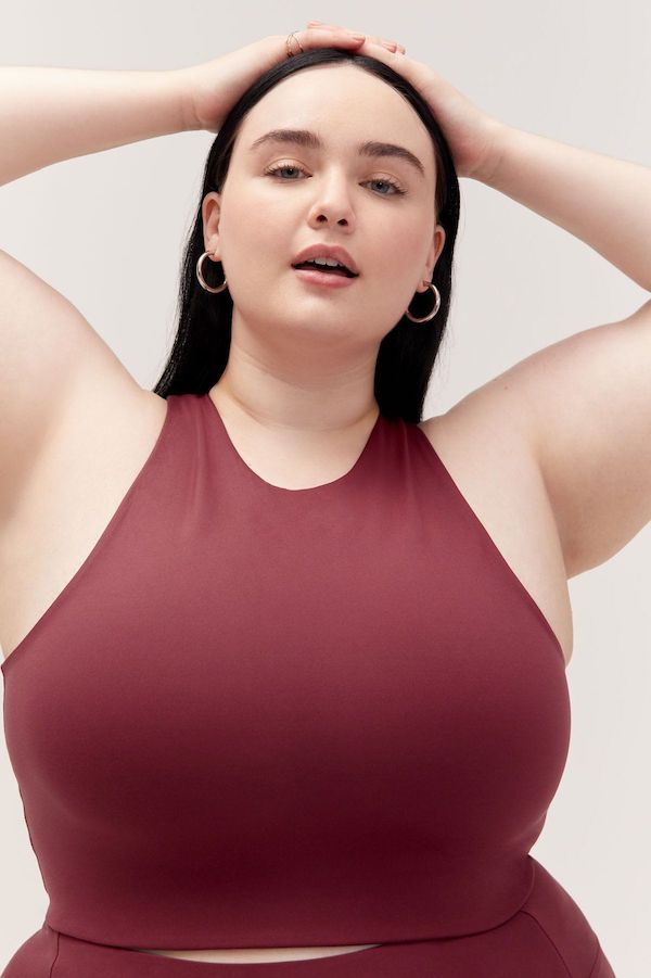 A plus-size model from Girlfriend wearing a wine red bra.