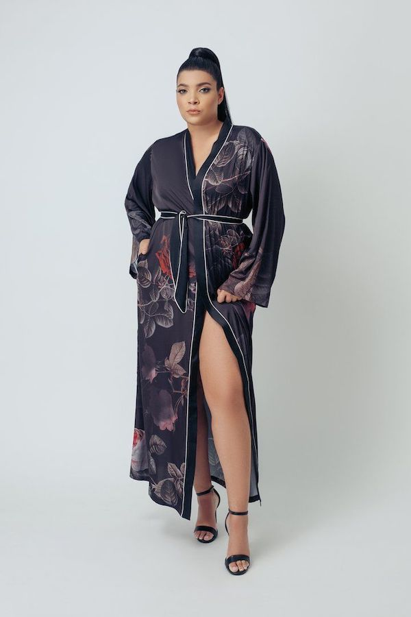 A plus-size model from Kilo Brava wearing a long silky robe.