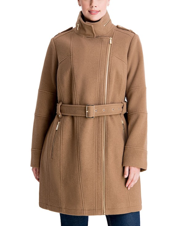 A plus-size model wearing a Michael Kors brown belted coat from Macy's.