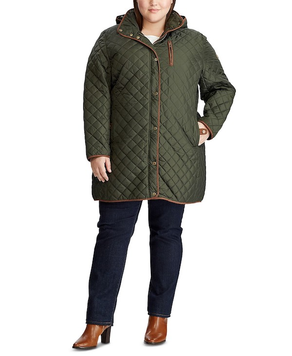 A plus-size model from Macy's wearing a green puffed coat.