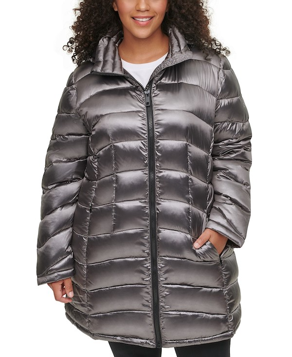 A plus-size model from Macy's wearing a metallic silver puffer coat.