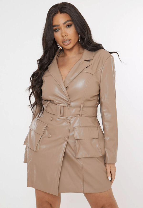 A plus-size model for Missguided wearing a faux leather blazer dress.