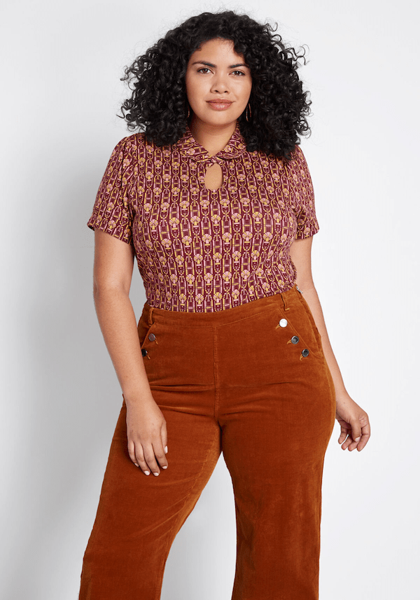A plus-size model from ModCloth wearing a red keyhole blouse.