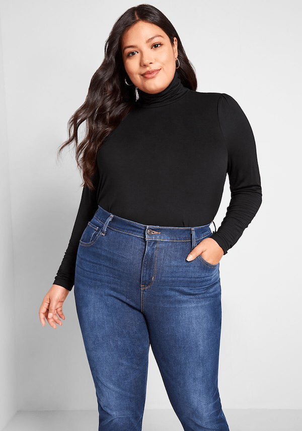 A plus-size model from ModCloth wearing a black turtleneck.