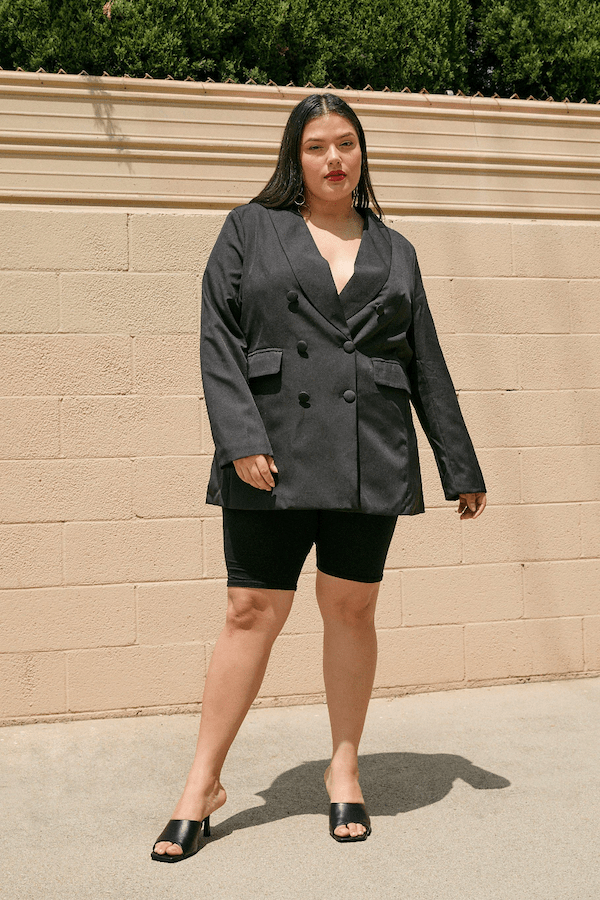A plus-size model from Nasty Gal wearing a gray oversized blazer.