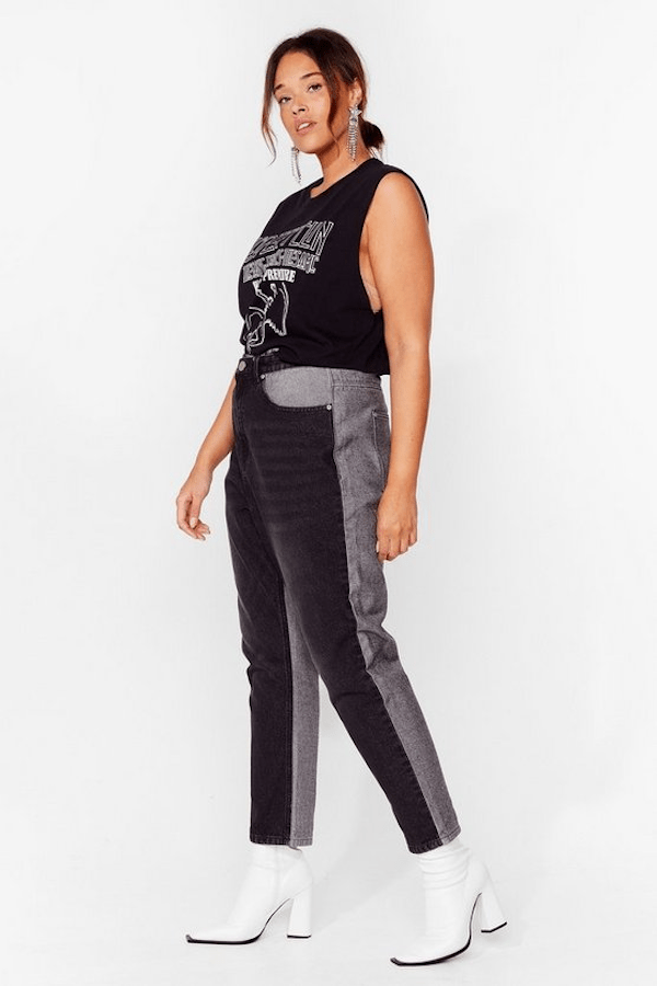 A plus-size model from Nasty Gal wearing gray and black mom jeans.