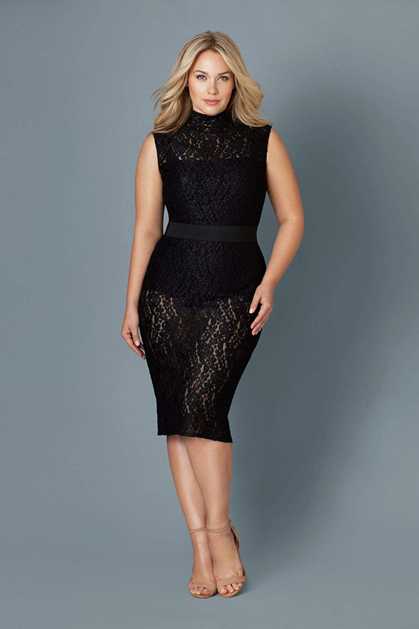 A plus-size model wearing a black cocktail dress, which is currently marked down at CoEdition's 2020 Black Friday sale.