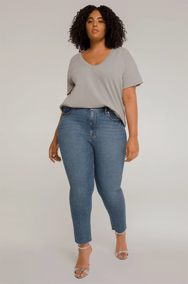 A plus-size model wearing skinny jeans, which will be marked down at Good American's 2020 Black Friday sale.