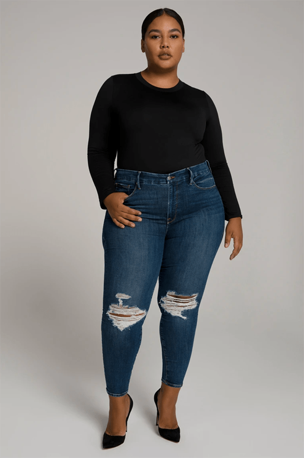 A plus-size model wearing distressed skinny jeans, which will be marked down at Good American's 2020 Black Friday sale.