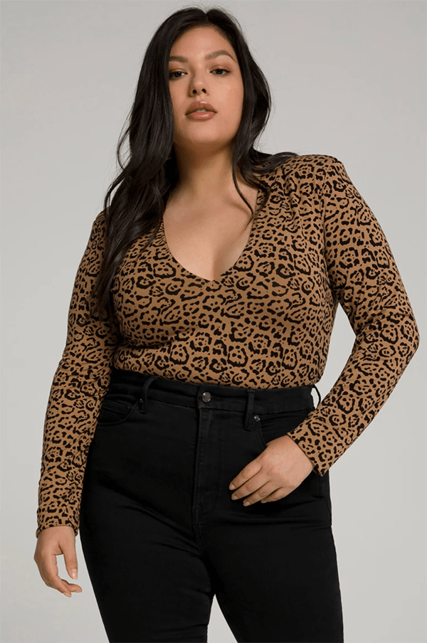 A plus-size model wearing an animal print bodysuit, which will be marked down at Good American's 2020 Black Friday sale.