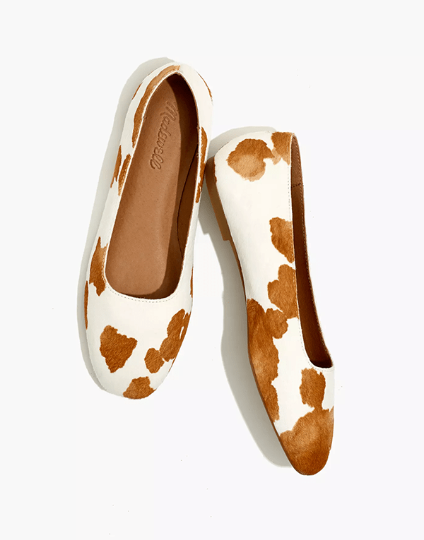 A pair of cow print flats, which will be marked down at Madewell's 2020 Black Friday sale.