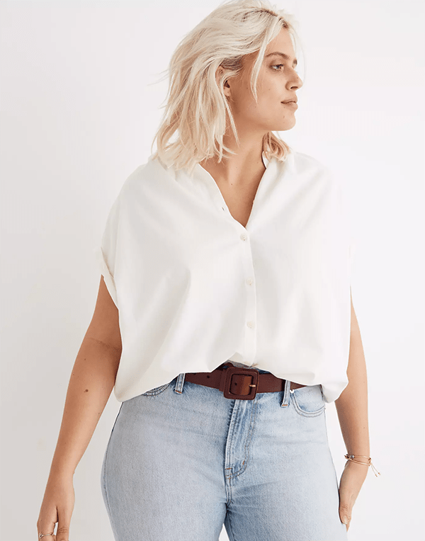 A plus-size model wearing a white blouse, which will be marked down at Madewell's 2020 Black Friday sale.