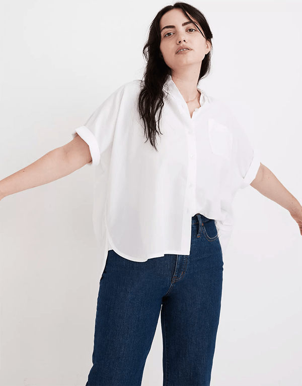 A plus-size model wearing a white short-sleeve button-down, which will be marked down at Madewell's 2020 Black Friday sale.