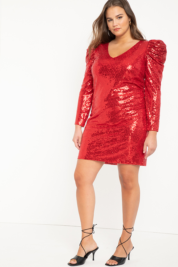 A plus-size model wearing a red sequin dress.