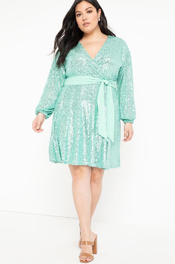 A plus-size model wearing an aqua sequin tie-waist dress.