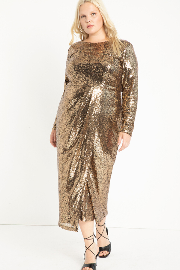 A plus-size model wearing a gold sequin dress.