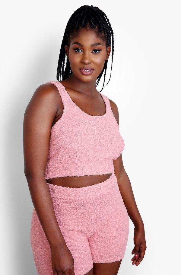 A model from Rebdolls wearing a fuzzy pink crop top.