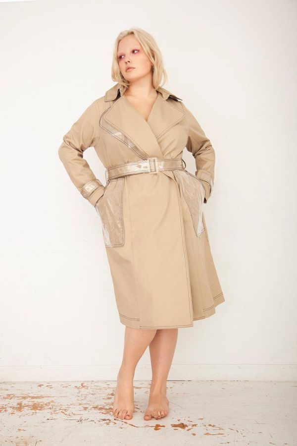 A plus-size model from Tamara Malas wearing a trench coat.