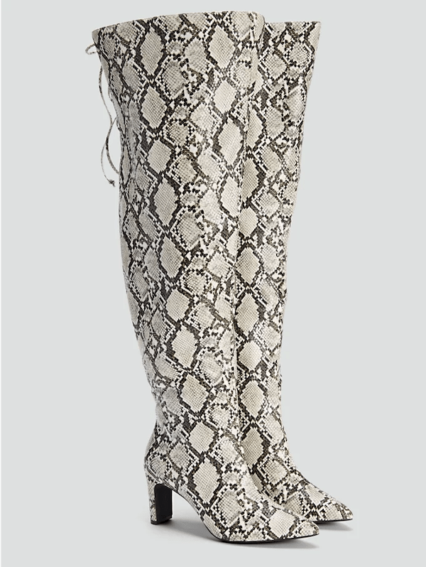 A pair of snake print wide-calf thigh-high boots.
