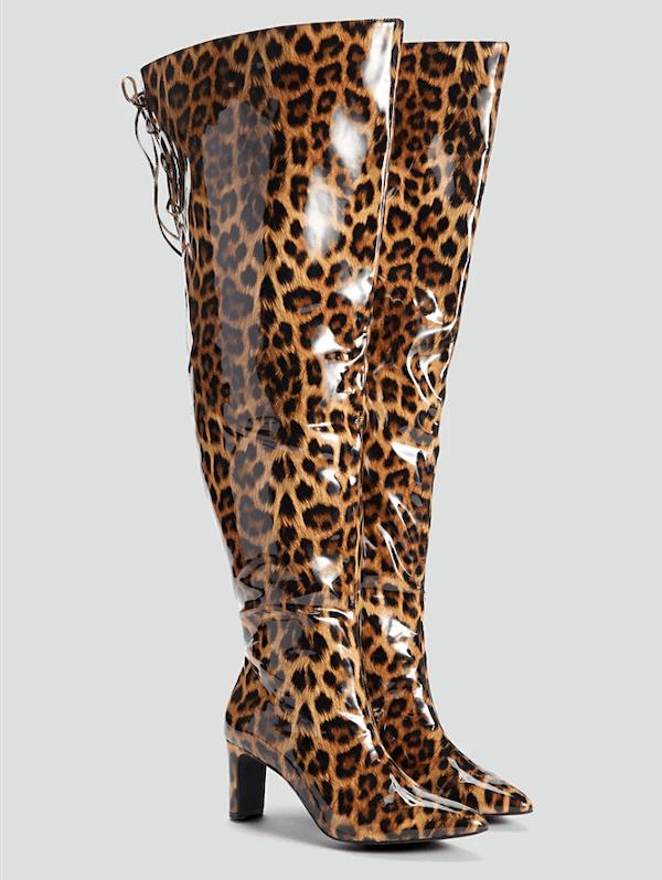 A pair of leopard print wide-calf thigh-high boots.