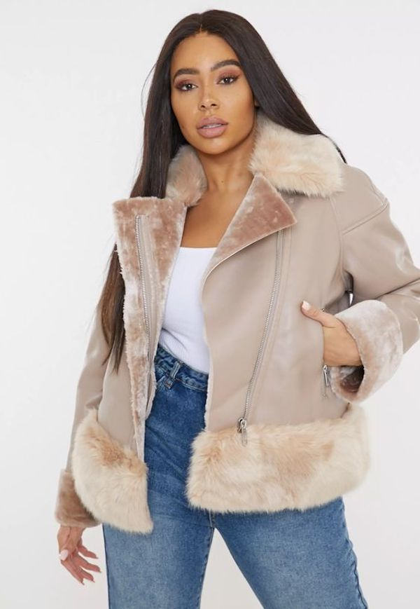 A model wearing a plus-size aviator jacket in light brown.