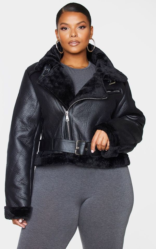 A model wearing a plus-size cropped aviator jacket in black.