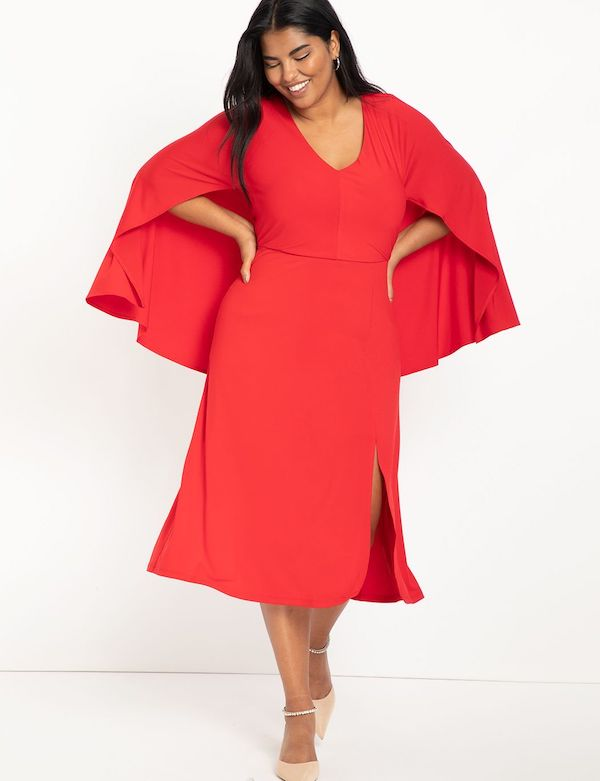 A model wearing a plus-size cape dress in red.