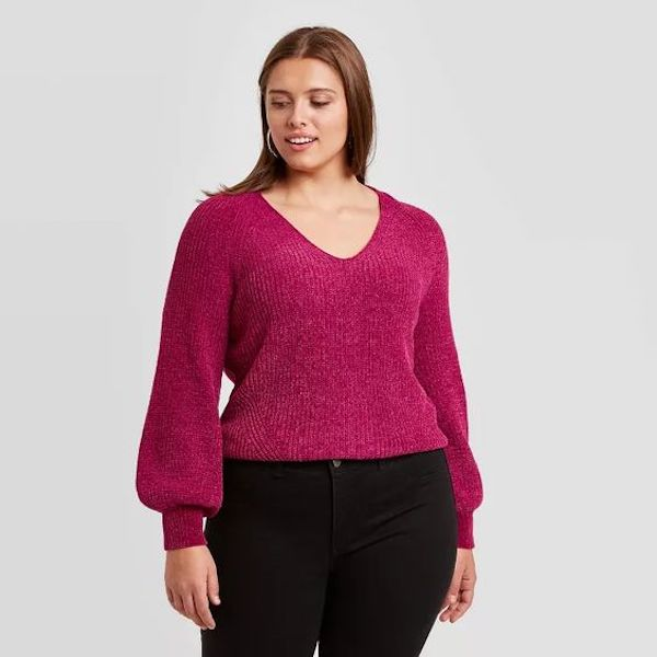 A model wearing a plus-size pink chenille sweater.