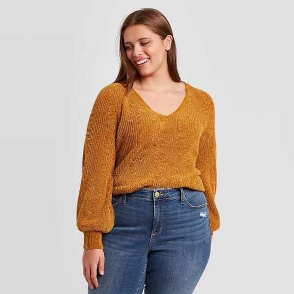 A model wearing a plus-size mustard chenille sweater.