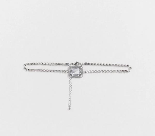 A silver choker necklace.