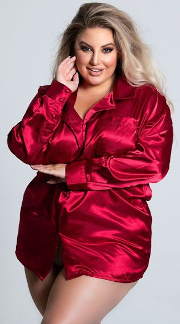 A model wearing plus-size red satin lingerie shirt.