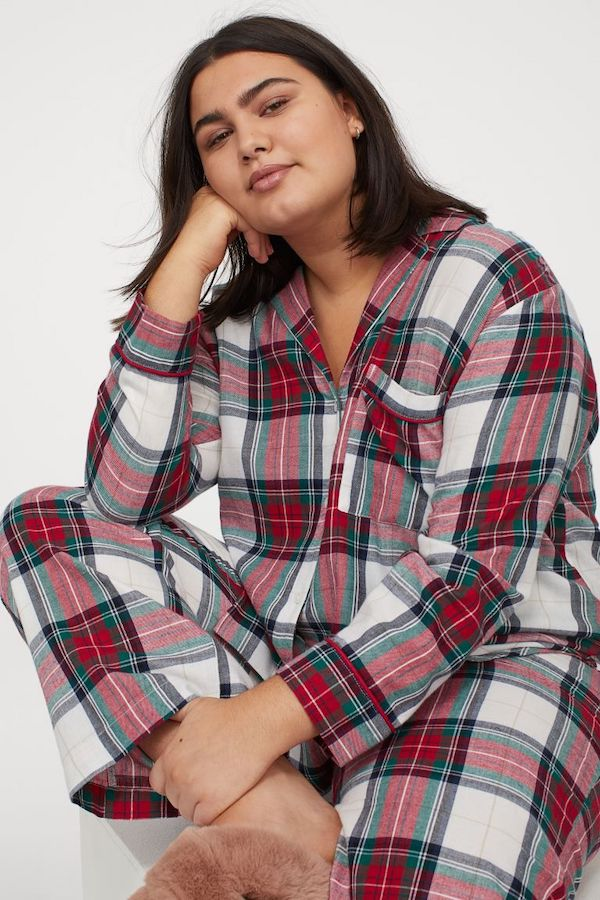A model wearing plus-size red plaid pajamas.