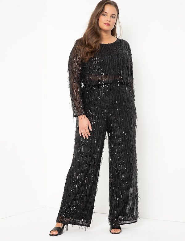 A model wearing plus-size fringe pants in sparkly black.