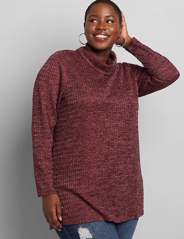 A model wearing a plus-size glitter top in red.