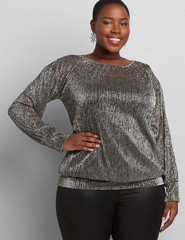 A model wearing a plus-size glitter top in silver.
