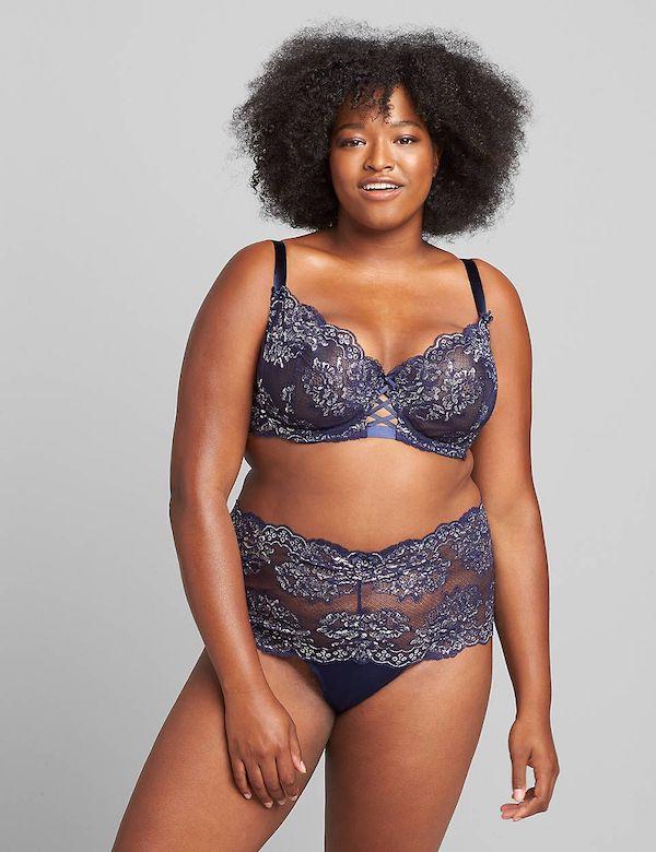 A model wearing a plus-size lingerie set in dark blue lace.