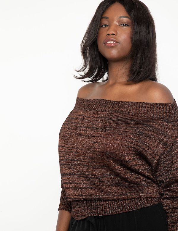 A model wearing a plus-size off-the-shoulder sweater in metallic brown.