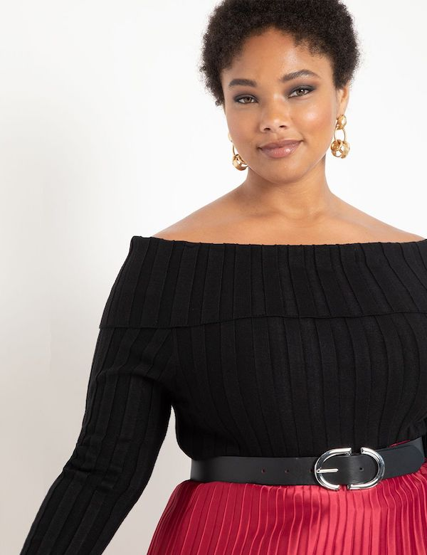 A model wearing a plus-size off-the-shoulder sweater in black.