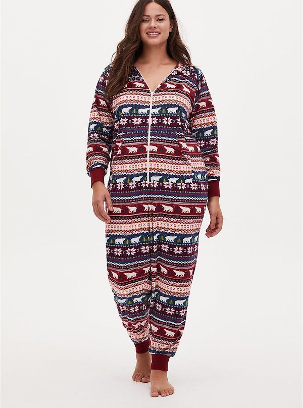 A model wearing a plus-size fair isle onesie.