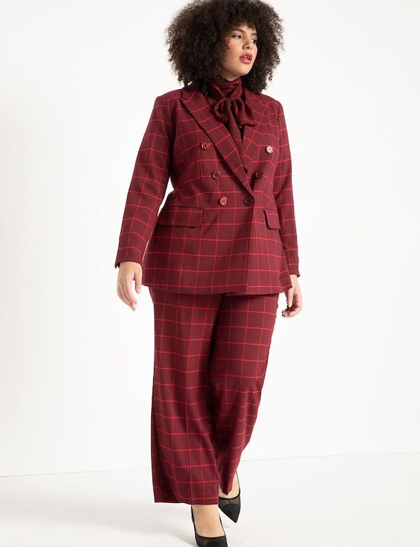 A model wearing a plus-size pant suit in dark berry.