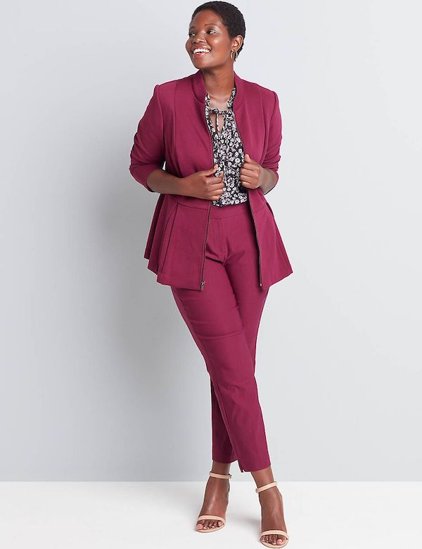 A model wearing a plus-size pant suit in berry.