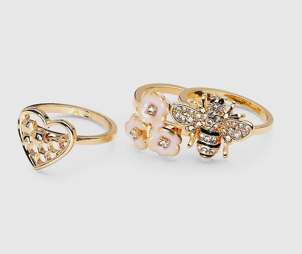 A plus-size set of gold rings featuring a heart, bee, and flowers.