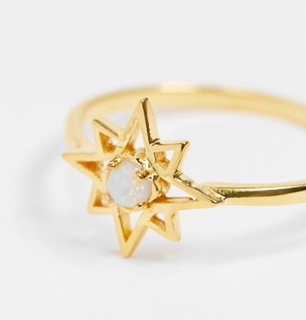 A plus-size gold ring in the shape of a star.