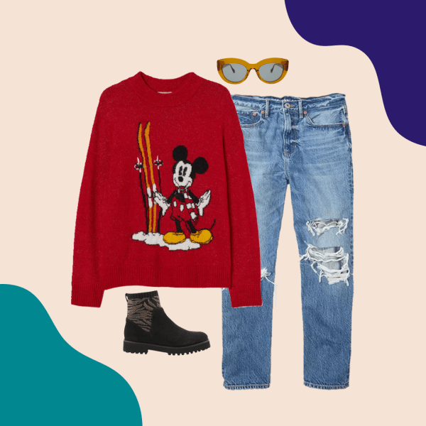 A red Mickey Mouse sweater, ripped mid-wash jeans, black booties, and yellow sunglasses.