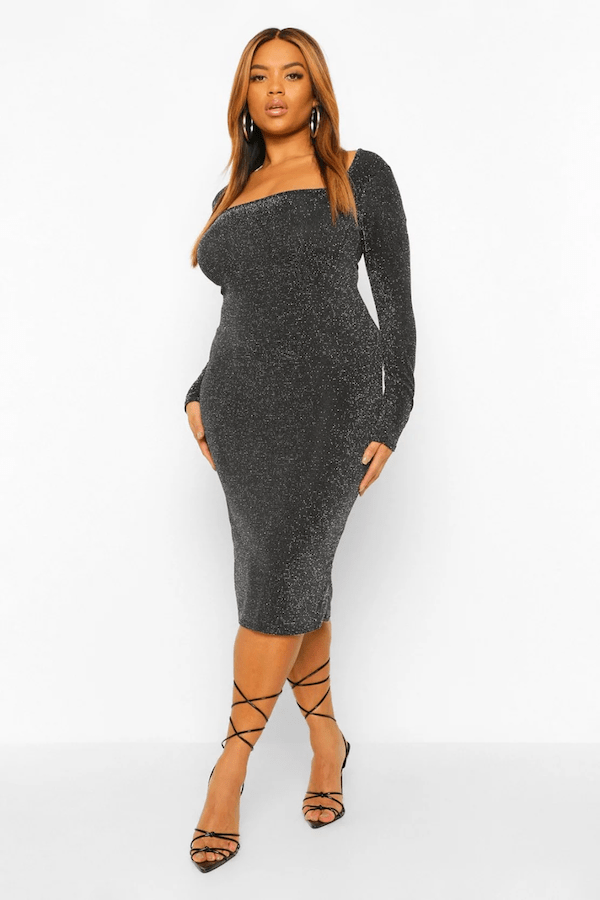 A model wearing a plus-size silver midi dress.