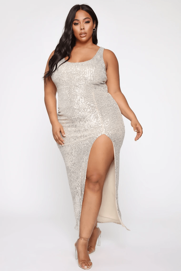 A model wearing a plus-size silver maxi dress.
