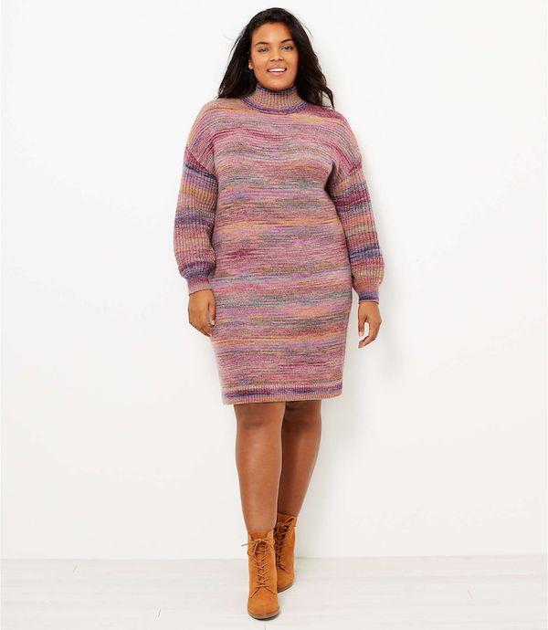 A model wearing a plus-size space dye sweater dress.