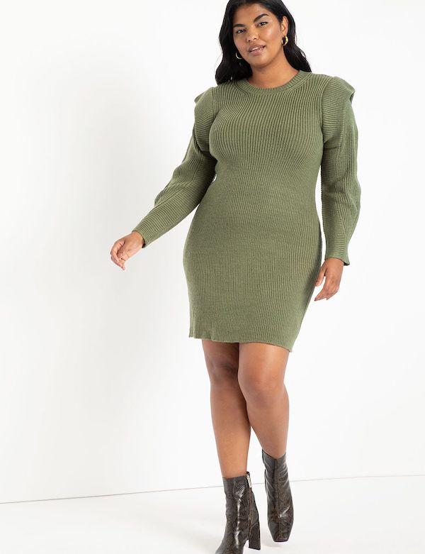 A model wearing a plus-size green sweater dress.