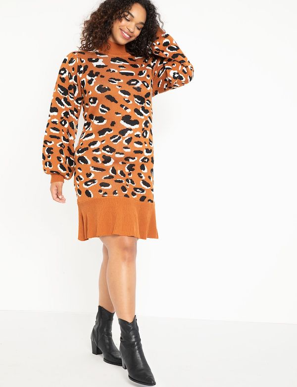 A model wearing a plus-size animal print sweater dress.