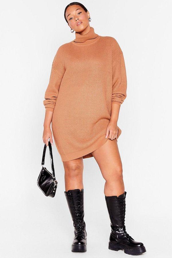 A model wearing a plus-size turtleneck dress in light brown.
